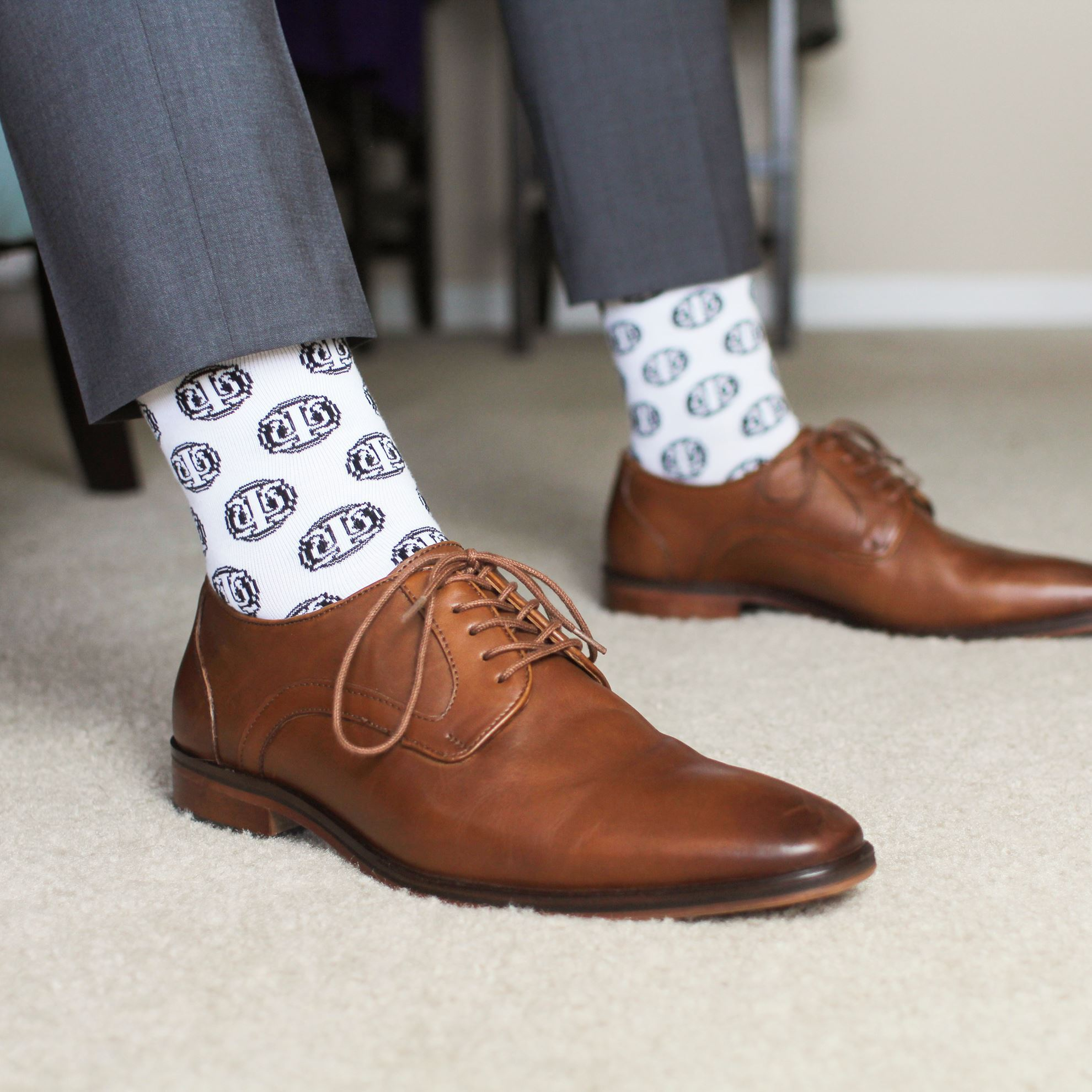 Socks with Psi Chi Seal pattern with dress shoes